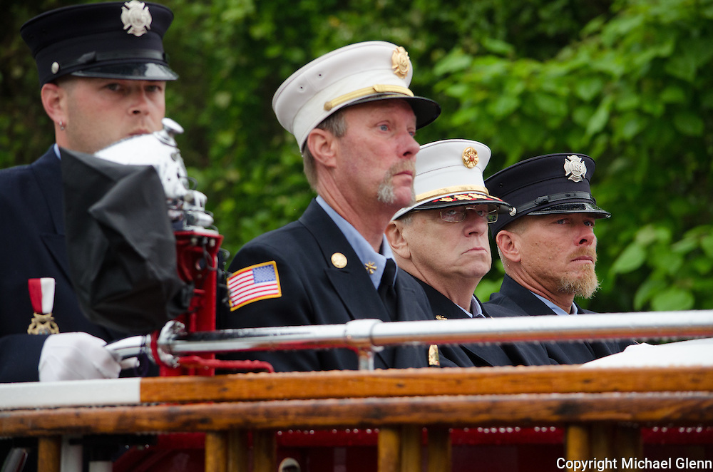 10Jun2013/Lanoka Harbor/NJ/USA/Funeral Service for LHFD Chief Kevin Perrone who died suddenly after a battle with Kidney failure. (l to r) Jack Conaty, Tom Bruce, Jack Amrozewicz, Michael Conti, ride the back of fire truck