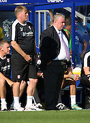 Steve Evans not looking to impressed after Charlie Austin (QPR striker) scored QPR's fourth goal during the Sky Bet Championship match between Queens Park Rangers and Rotherham United at the Loftus Road Stadium, London, England on 22 August 2015. Photo by Matthew Redman.