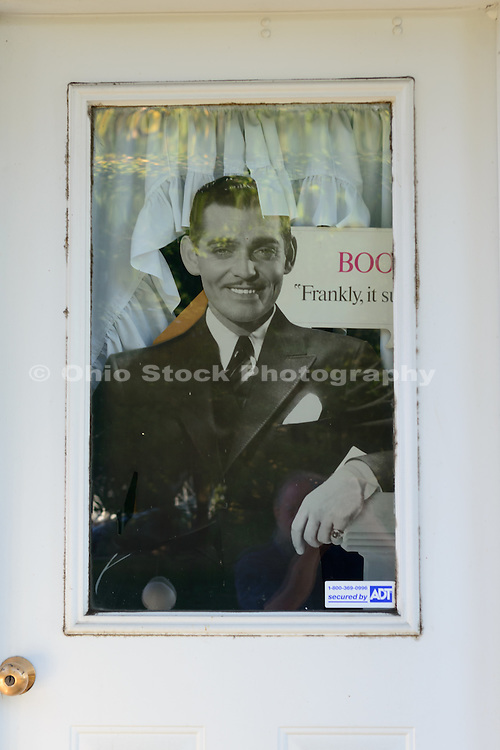 Photo of a picture of Clark Gable in the window of the house where he was born in Cadiz, Ohio.