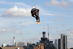 © Licensed to London News Pictures. 29/10/2011, London, UK.  Switzerland's Joel Staub jumps during a qualification heat of the FIS Snowboard World Cup Bir Air competition at the Freeze Snowboard and Ski Festival at Battersea Power Station in London, Saturday, Oct. 29, 2011. Photo credit : Sang Tan/LNP