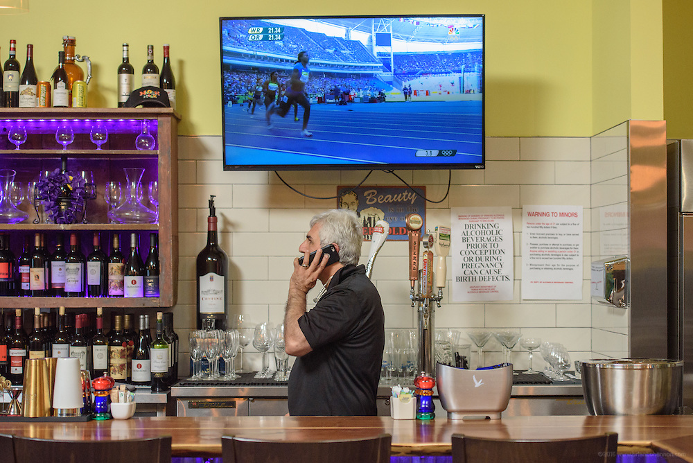 Chef/Owner Anoosh Shariat walks as he talks, behind the bar at Noosh Nosh. Photos at Anoosh Shariat's anoosh Bistro and Noosh Nosh Monday, Aug. 15, 2016. (Photo by Brian Bohannon)