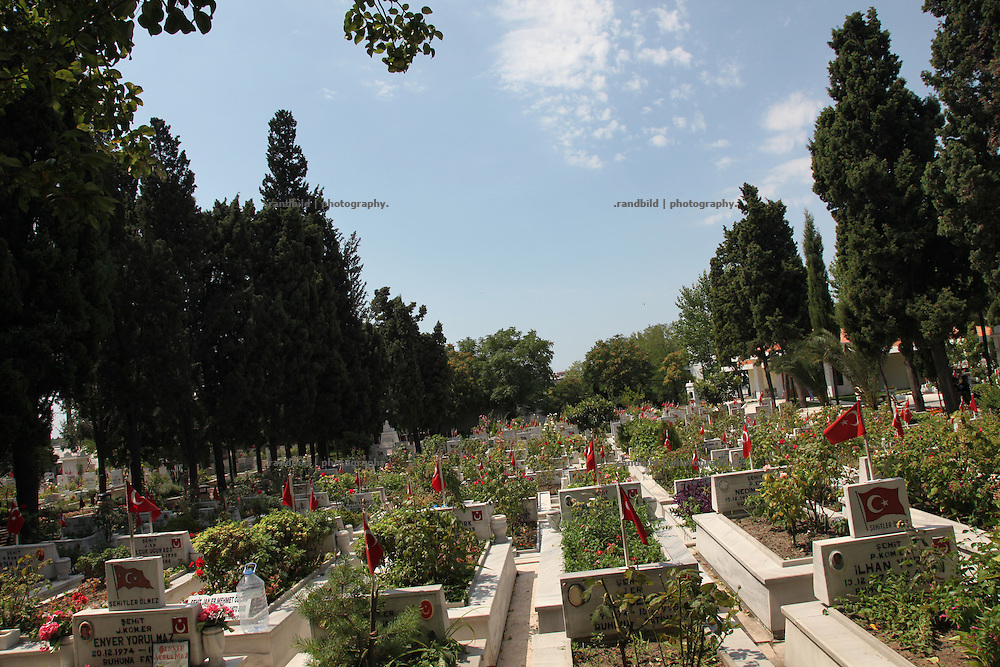 Graves of fallen turkish soldiers on the ground of Istanbuls central cemetery of heroes.
