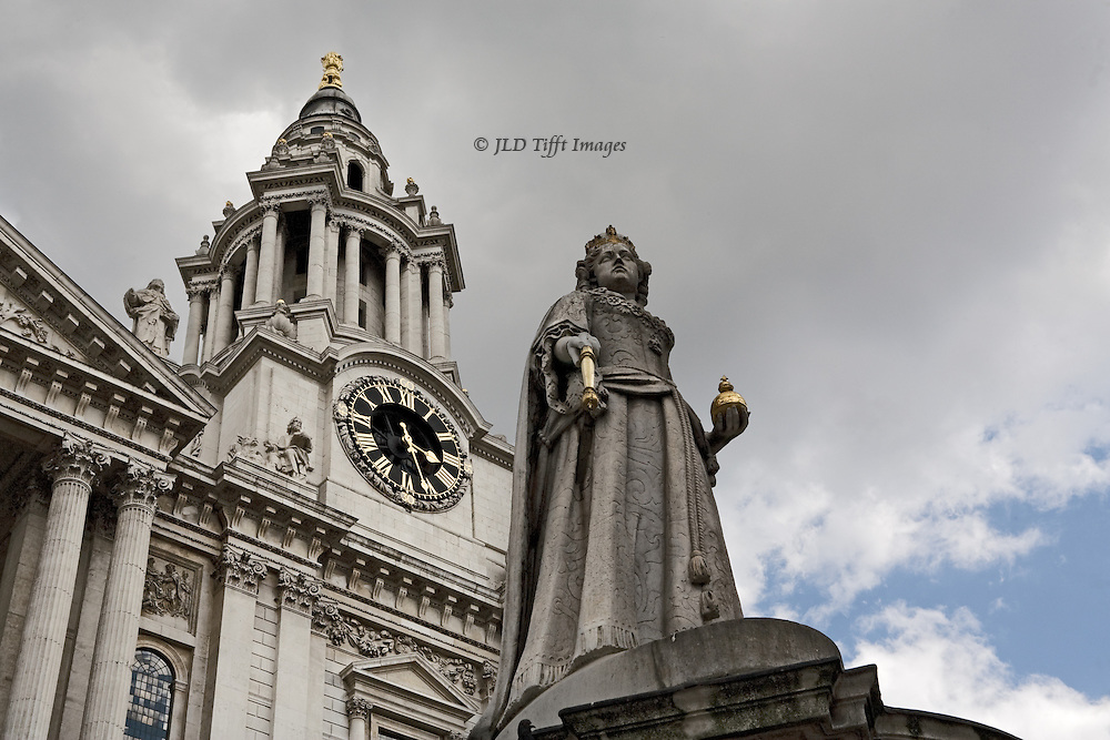 Replacement statue of Queen Anne in front of St. Paul's Cathedral.  Looking up at the statue and the southwest clock tower of the cathedral.