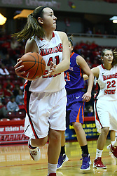 01 January 2012:  Marley Hall saves the ball from out of bounds during an NCAA women's basketball game between the Evansville Purple Aces and the Illinois Sate Redbirds at Redbird Arena in Normal IL