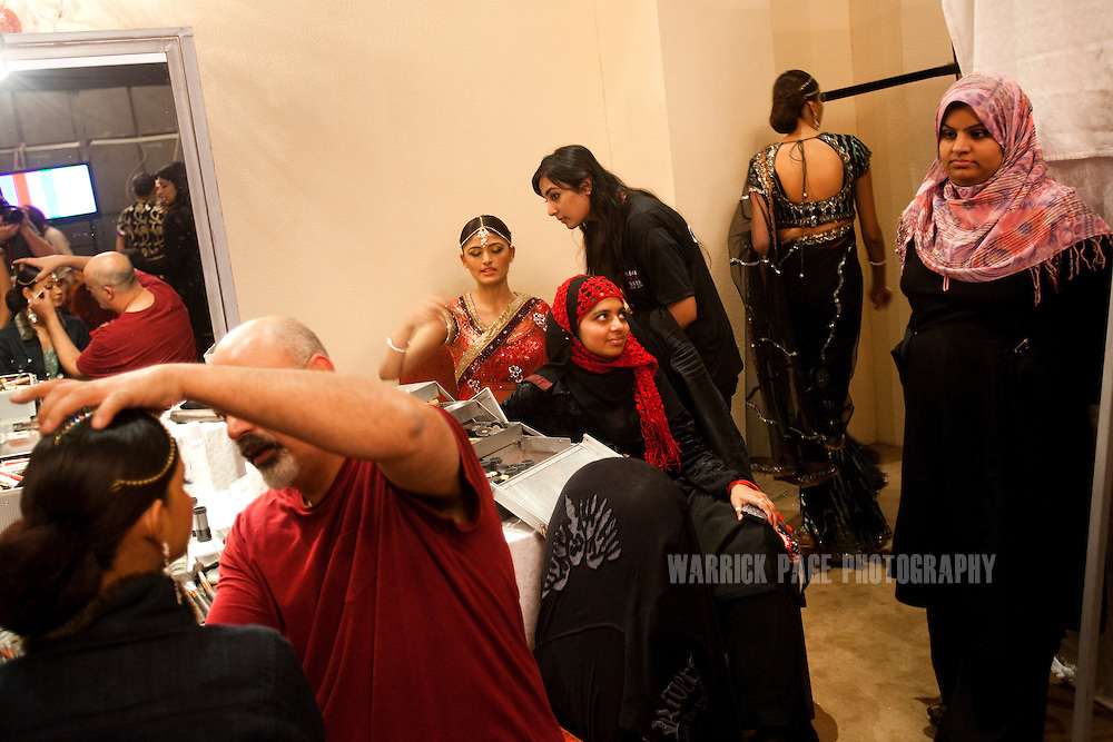 Assistants watch models prepare for the runway, backstage on the second day of the Islamabad Fashion Week, on 28 January, 2011, in Islamabad, Pakistan. Renowned Pakistani fashion designers showcase their wares over 4 days in the countries capital. Pakistan faces an ongoing social struggle between modernity and conservativeness with the country strongly divided over the role and influence of religion in society. (Photo by Warrick Page)