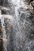 Ticino, Southern Switzerland. Close-up of a stream of water in a waterfall. Good background and texture.