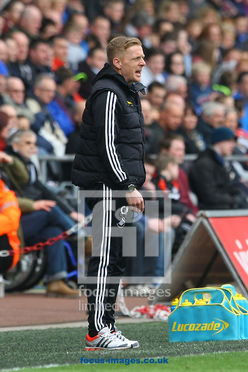 Swansea Head Coach Garry Monk during the Barclays Premier League match at the Liberty Stadium, Swansea<br /> Picture by Paul Chesterton/Focus Images Ltd +44 7904 640267<br /> 29/03/2014