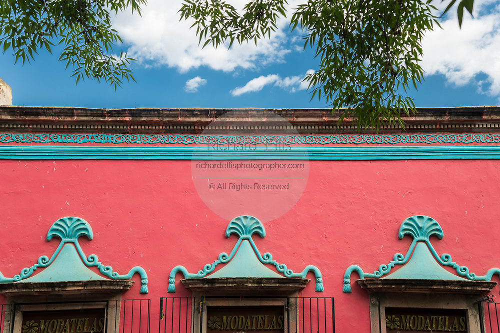 A colorful Spanish colonial style building along the Plaza Principal in Dolores Hidalgo, Guanajuato, Mexico. Miguel Hildago was a parish priest who issued the now world famous Grito - a call to arms for Mexican independence from Spain.