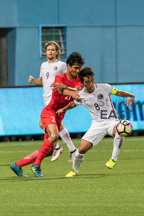 SINGAPORE, SINGAPORE - AUGUST 31: Safuwan Baharudin of Singapore (L) fights Lam Ka Fai of Hong Kong (R) for the ball during the international friendly match between Singapore and Hong Kong at the Jalan Besar Stadium on August 31, 2017, in Singapore, Singapore. (Photo by Getty Images)