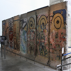 February 6, 2018 - Washington, District of Columbia, U.S - A concrete segment of the Berlin Wall that is preserved in the Newseum in Washington, DC.  This image shows the eight 12-foot tall concrete sections from the West Berlin side, covered in graffiti containing art and messages.  Using August 13th, 1961 as the 'start' of the Berlin Wall, and November 9th, 1989 as the fall' of the wall, the Berlin Wall has now been 'down' longer than it was 'up' in Germany. (Credit Image: © Evan Golub via ZUMA Wire)