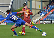 Eoghan O'Connell tries to stop the cross from Billy Knott during the Sky Bet League 1 match between Oldham Athletic and Bradford City at Boundary Park, Oldham, England on 5 September 2015. Photo by Mark Pollitt.