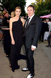SIMON and YASMIN LE BON at the Serpentine Gallery Summer party sponsored by Yves Saint Laurent held at the Serpentine Gallery, Kensington Gardens, London W2 on 11th July 2006.<br />