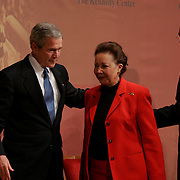 """Presidential Inauguration 2005- GEORGE W. BUSH.Washington, DC. Georgetown University's """"Let Freedom Ring"""" celebration honoring Dr. Martin Luther King, Jr. at the John F. Kennedy Center for the Performing Arts, Monday, Jan. 17, 2005, in Washington. .President Bush, Coretta Scott King, Secretary of State Colin Powell..Photo by Khue Bui...US President George W Bush greets Secretary of State Colin Powell and wife Alma."""