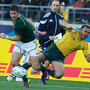 Digby Ioane, Australia, is taken out by Morne Steyn, South Africa, during the South Africa V Australia Quarter Final match at the IRB Rugby World Cup tournament. Wellington Regional Stadium, Wellington, New Zealand, 9th October 2011. Photo Tim Clayton...