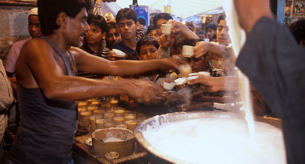 A popular tea stall in Old delhi near the Jama Masjid where th chai walla is making tea with malai (milk foam). .The Chaiwalla (tea vendor) is a well-entrenched street entrepreneur in Delhi. Indian massala tea is prepared with milk, ginger, cardamom and cloves and has a distinctive taste. One can have a glass of chai at any time of day and night in Delhi.