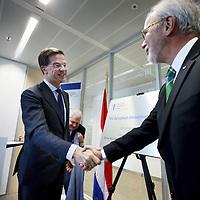 Nederland, Amsterdam , 15 mei 2014. <br /> Minister-president Rutte (l) opende donderdag 15 mei de Nederlandse vestiging van de Europese Investeringsbank (EIB) in Amsterdam. <br /> Werner Hoyer (r), de president van de EIB .De EIB is het financieringsinstituut van de Europese Unie.<br /> De 28 lidstaten zijn aandeelhouder. De bank is opgericht in 1958 bij het Verdrag van Rome en heeft als doel projecten te financieren die zijn gericht op de versterking van de Europese economie.<br /> Prime Minister Rutte (l) opened Thursday, May 15th, the Dutch branch of the European Investment Bank (EIB) in Amsterdam. Werner Hoyer, president of the EIB (right).<br /> <br /> The EIB is the financing institution of the European Union.