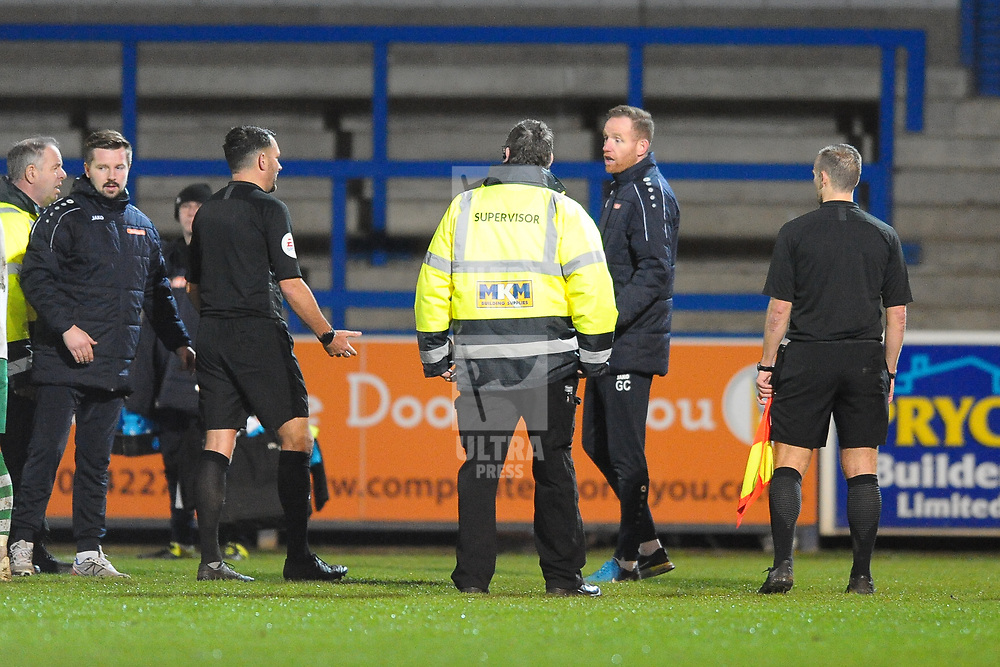 TELFORD COPYRIGHT MIKE SHERIDAN Telford boss Gavin Cowan makes his feelings known to referee David McNamara after Ellis Deeney is sent off after the final whistle during the Vanarama Conference North fixture between AFC Telford and Farsley Celtic at the New Bucks head Stadium on Saturday, December 7, 2019.<br />