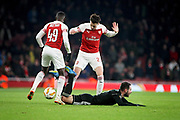 Arsenal's Carl Jenkinson (25) and Arsenal's Eddie Nketiah (49) protesting their innocence during the Europa League group stage match between Arsenal and FK QARABAG at the Emirates Stadium, London, England on 13 December 2018.