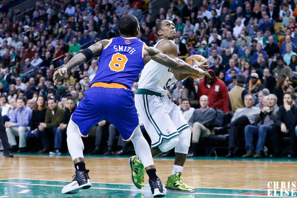 24 January 2013: Boston Celtics point guard Rajon Rondo (9) drives past New York Knicks shooting guard J.R. Smith (8) during the New York Knicks 89-86 victory over the  at the TD Garden, Boston, Massachusetts, USA.