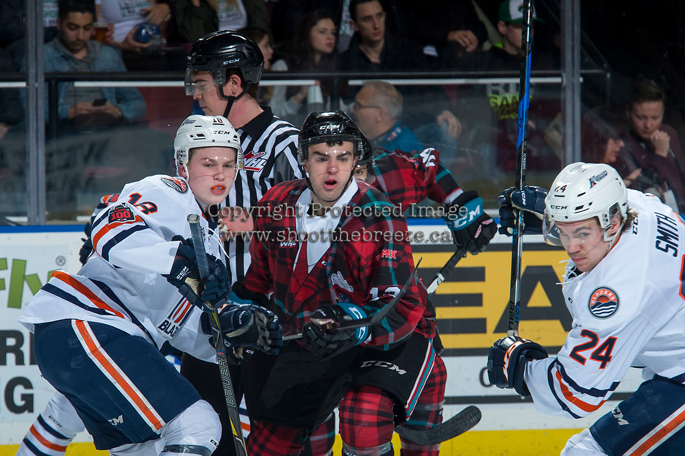 KELOWNA, CANADA - MARCH 10: Connor Zary #18 of the Kamloops Blazers checks Erik Gardiner #12 of the Kelowna Rockets after the face off  on March 10, 2018 at Prospera Place in Kelowna, British Columbia, Canada.  (Photo by Marissa Baecker/Shoot the Breeze)  *** Local Caption ***