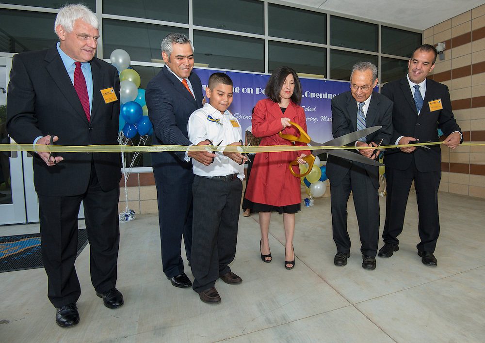 L-R: Dr. James Benfield, Rudy Trevino, Adrian Palacios, trustee Juliet Stipeche, Felix Fraga and principal Eduardo Sindaco cut the ribbon during an opening ceremony at The Rusk School, April 7, 2014.