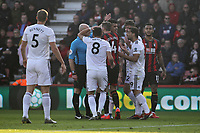 Football - 2018 / 2019 Premier League - AFC Bournemouth vs. Wolverhampton Wanderers<br /> <br /> Wolves players surround Referee Roger East after there appeals for a first half penalty are turned down during the Premier League match at the Vitality Stadium (Dean Court) Bournemouth  <br /> <br /> COLORSPORT/SHAUN BOGGUST