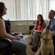 ARLINGTON, VA -JUNE3:  Tiffany Jolliff, who is blind, talks with lawyers Deepa Goraya and Peter Romer-Friedman, from the the Washington Lawyers' Committee for Civil Rights and Urban Affairs, after they filed a lawsuit Thursday in federal district court in the Eastern District of Virginia on behalf of Tiffany Jolliff against Uber, alleging violations of the Americans With Disabilities Act and the Virginians with Disabilities Act, alleging Uber unlawfully refused to accommodate Jolliff, who is blind, and her service dog, Railey. The complaint alleges that Jolliff, who works as a policy specialist for the federal government on employment for workers with disabilities, has been repeatedly discriminated against and denied Uber's services when Uber's drivers have seen that she is accompanied by her service dog Railey. Specifically, instead of accommodating her service dog Railey, as both the ADA and VDA require, Uber drivers have repeatedly driven off upon seeing that Ms. Jolliff had a service dog. (Photo by Evelyn Hockstein/For The Washington Post)