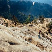 Rex Flake drops a major rock feature with early morning sun near Leavenworth, Washington.