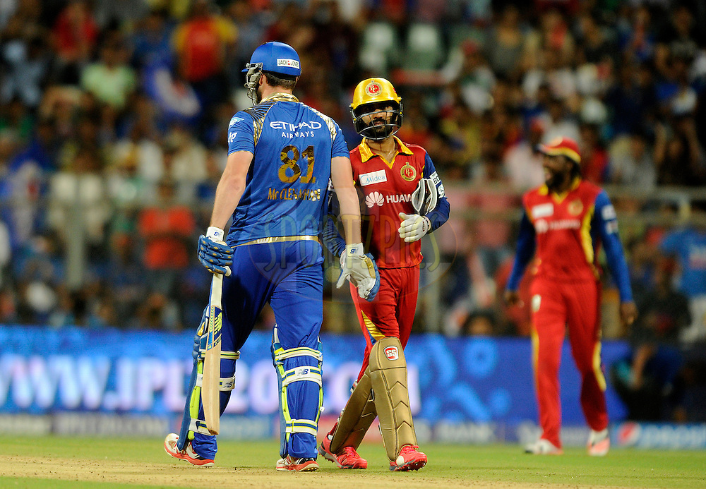 Mitchell McClenaghan of Mumbai Indians shakes hand with Dinesh Karthik of Royal Challengers Bangalore during match 46 of the Pepsi IPL 2015 (Indian Premier League) between The Mumbai Indians and The Royal Challengers Bangalore held at the Wankhede Stadium in Mumbai, India on the 10th May 2015.<br /> <br /> Photo by:  Pal Pillai / SPORTZPICS / IPL