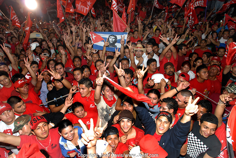 The FMLN victory party at Masferrer Plaza in San Salvador. The crowd was celebrating the election of former journalist Mauricio Funes of the FMLN party to be president of El Salvador.<br /> <br /> The FMLN became a political party after the 1992 peace agreement which ended El Salvador's 12 year civil war. Before the agreement the FMLN was a group of leftist guerrillas that fought the US funded right wing government.