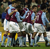 Picture: Henry Browne.<br /> Date: 11/02/2004.<br /> Fulham v Aston Villa FA Barclaycard Premiership.<br /> <br /> Darius Vassell is mobbed by team mates after he scores Villa's second goal.