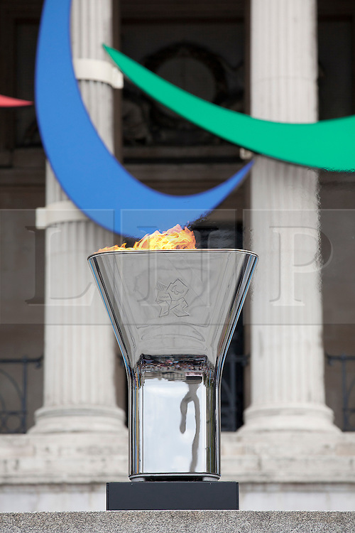 © Licensed to London News Pictures. 24/08/2012. LONDON, UK. The Trafalgar Square Paralympic cauldron is seen with the Paralympic Agitos in Trafalgar Square after being lit by disability campaigner Claire Lomas in London today (24/08/12). Photo credit: Matt Cetti-Roberts/LNP