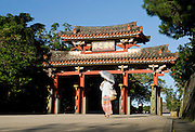 A visitor walks through Shureimon Gate inside the grounds of Shuri-jo Castle park in Naha, Okinawa Prefecture, Japan, on June 25, 2012. Shureimon was built during the reign of King Sho Sei, 1527-1555. Photographer: Robert Gilhooly