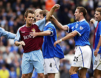 Picture: Henry Browne.<br />Date: 19/10/2003.<br />Birmingham City v Aston Villa FA Barclaycard Premiership.<br />Lee Hendry has a tussle with Matthew Upson just before he is substituted