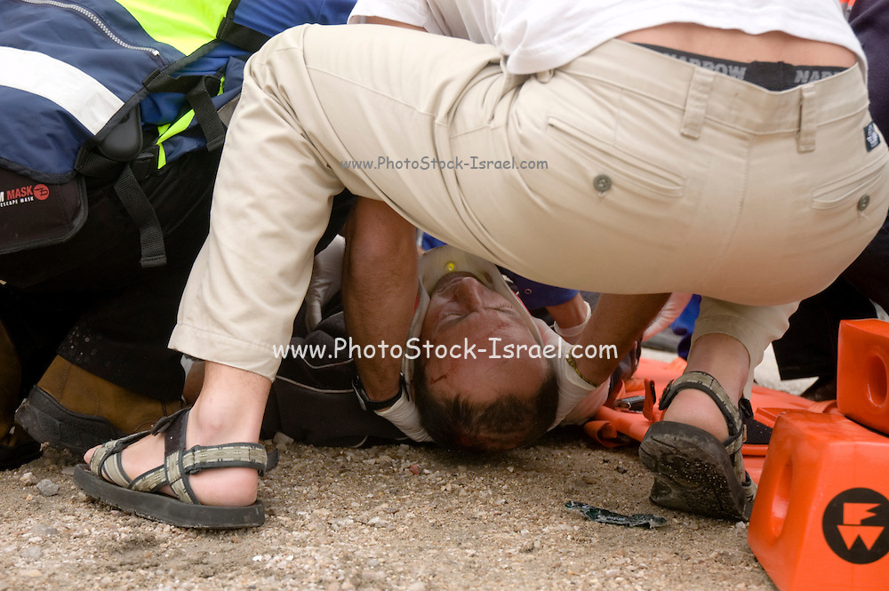 Israel, Judea Desert, Sdom, an overturned truck on the narrow winding slopes leading from the Dead Sea to Dimona The driver is receiving first aid medical care