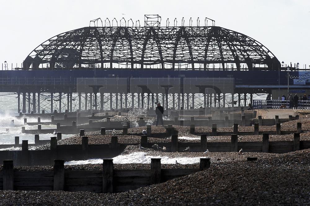 © Licensed to London News Pictures. 10/10/2014<br /> EastBourne Pier frame work .<br /> Eastbourne Seafront today (10.10.2014) <br /> A windy sunny day on Eastbourne seafront in East Sussex.<br /> (Byline:Grant Falvey/LNP)