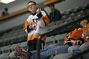 Jacob Marrer, 11, plays the air guitar during an exhibition game at RIT's Gene Polisseni Center on Monday, September 29, 2014.