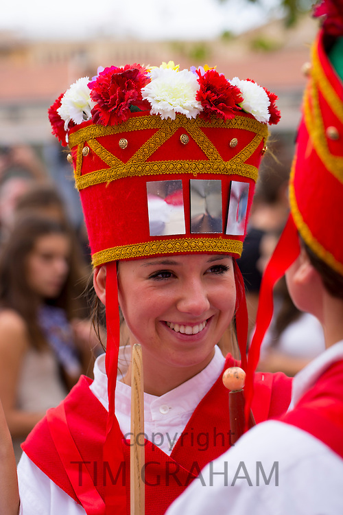 Dancer in procession through the streets during San Fermin Fiesta at Pamplona, Navarre, Northern Spain