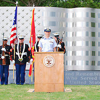 U.S. Coast Guard Lt. Lisa A. Taylor sings the National Anthem during the dedication ceremony for the new Friendswood Veterans Memorial that was dedicated today.