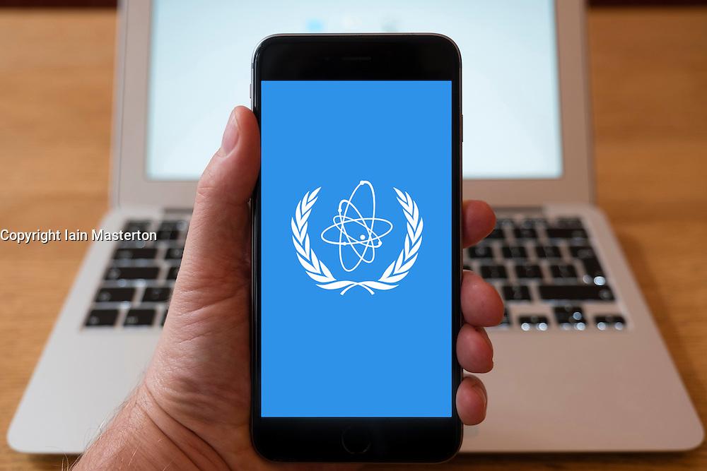 Using iPhone smart phone to display website logo of IAEA, International Atomic Energy Authority