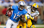 Detroit Lions wide receiver Jeremy Ross (12) runs the ball past Green Bay Packers cornerback Jarrett Bush (24) and cornerback Davon House (31) during an NFL football game at Ford Field in Detroit, Thursday, Nov. 28, 2013. (AP Photo/Rick Osentoski)