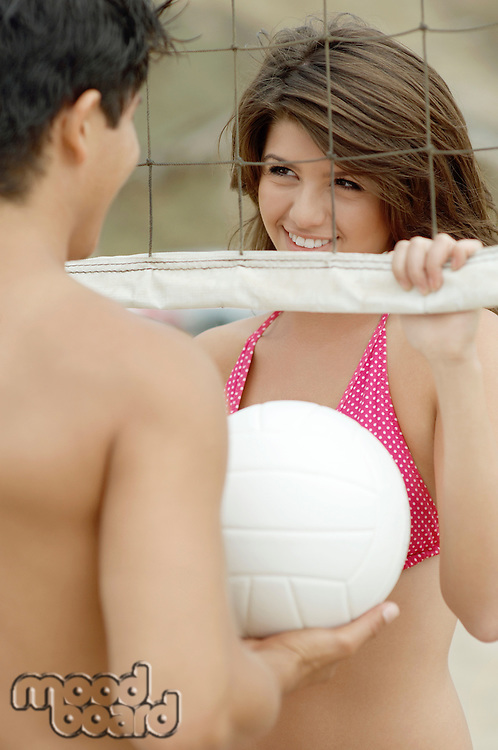 Couple Flirting by Volleyball Net