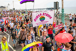 © Licensed to London News Pictures. 21/07/2016. Brighton, UK. Members of the Trans and LGBT community take part in the 2018 Trans Pride parade on the seafront in Brighton and Hove. Photo credit: Hugo Michiels/LNP