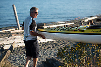 Unloading kayaks in Victoria, BC, on a sunny summer evening, ready for a paddle in the Esquimalt Lagoon and harbour.
