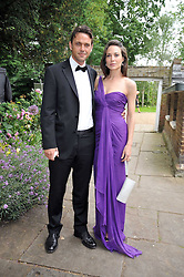 DOUGRAY SCOTT and his wife Claire Forlani at the Raisa Gorbachev Foundation fourth annual fundraising gala dinner held at Stud House, Hampton Court, Surrey on 6th June 2009.