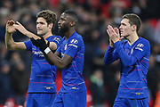 Chelsea defender Marcos Alonso (3), Chelsea defender Antonio Rudiger (2) and Chelsea defender Andreas Christensen (27) applaud the visiting fans after the EFL Cup Semi-Final match between Tottenham Hotspur and Chelsea at Wembley Stadium, London, England on 8 January 2019.