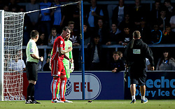 Aden Flint of Bristol City gestures to the Wycombe Wanderers groundsman to remove a nearly dead bird off the pitch - Mandatory by-line: Robbie Stephenson/JMP - 09/08/2016 - FOOTBALL - Adams Park - High Wycombe, England - Wycombe Wanderers v Bristol City - EFL League Cup