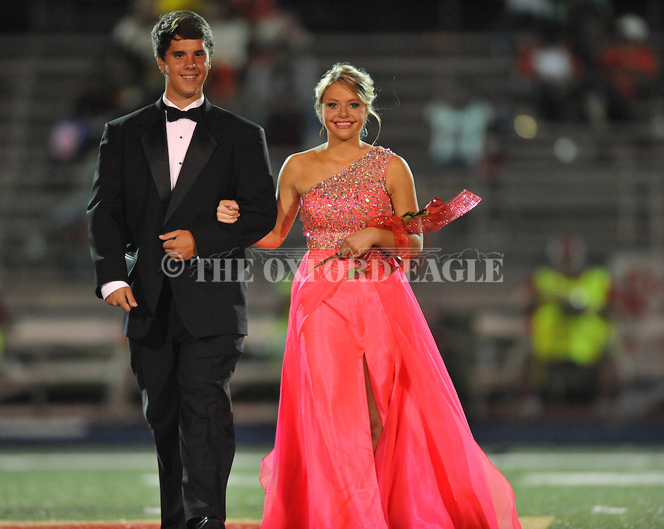 Senior maid Josie Smith is escorted by Garrett Carter during Homecoming at Lafayette High vs. Shannon in Oxford, Miss. on Friday, September 19, 2014. Lafayette High won 35-0 to improve to 2-3 on the season.