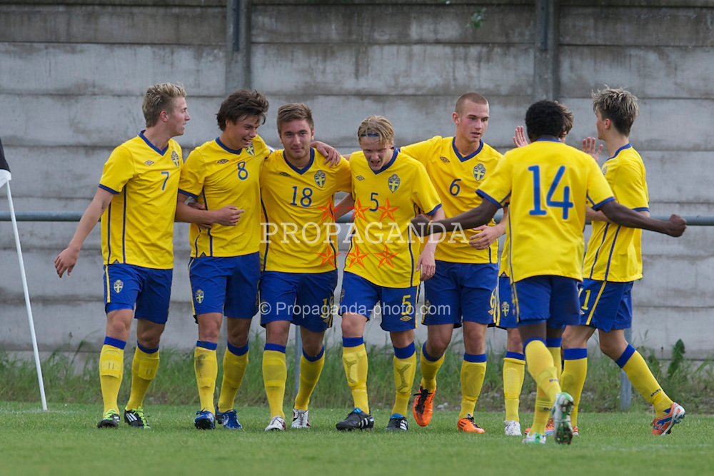 FLINT, WALES - Thursday, May 12, 2011: Sweden's Muamer Tankovic (#18) celebrates scoring the third goal against Wales during the Men's Under-17's International Friendly match at Cae-y-Castell. (Photo by David Rawcliffe/Propaganda)