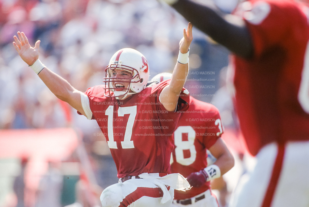 COLLEGE FOOTBALL: Stanford vs SJS played on September 26, 1992 at Stanford Stadium in Palo Alto, California.  John Lynch #17 SU celebrates.